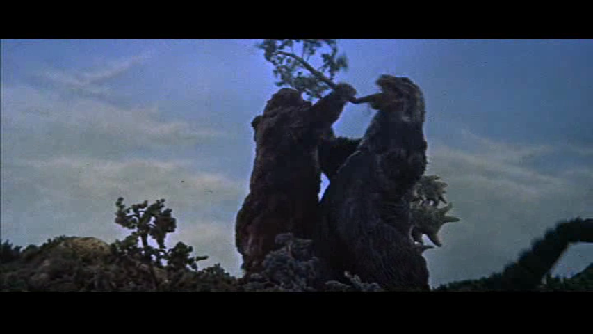 King-Kong-vs-Godzilla-tree-in-throat.png.0b3c98a4e08ea8c13a88e92aafcc3576.png